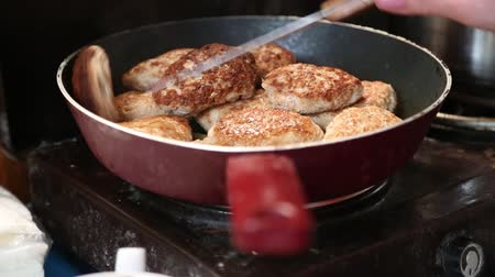 reheat : Pan with cutlets on electric kitchen range Stock Footage