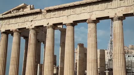 reconstructed : Columns of Parthenon - antique temple in Athenian Acropolis in Greece, dedicated to the goddess Athena, whom the people of Athens considered their patron Stock Footage