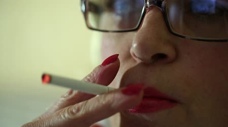 carcinogenic : Woman with a cigarette. Female smoker, close up shot