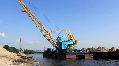 operacional : Big floating crane and barge on the river