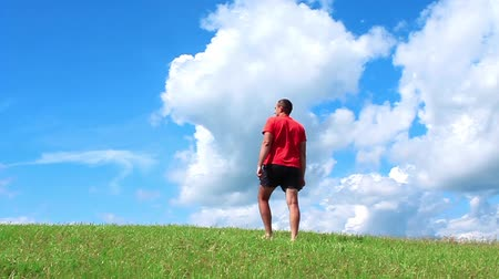 yanaklar : Healthy life-style. Man on red t-shirt on green grass