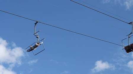 slalom : Chair lift on sky background