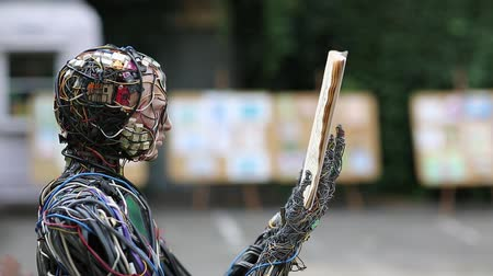 kondüktör : UKRAINE, KIEV, AUGUST 17, 2016: Cyborg with book in hands. Sculpture of human, made of electric wires and electronic devices. Robot reads a book