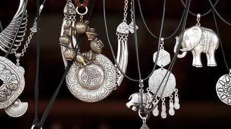 bugiganga : UKRAINE, KIEV, AUGUST 14, 2016: Jewellery made of silver, amulets, talismans, charms. Market jewels