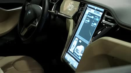 motorcar : UKRAINE, KIEV, JUNE 10, 2016: Exhibition of electric cars. Inside Tesla electromobile. Tesla electromobile interior