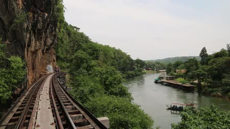Канчанабури : THAILAND, KANCHANABURI PROVINCE, APRIL 5, 2014: People on old railroad near Kwai river in Thailand