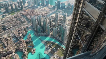 UAE, DUBAI, JANUARY 31, 2016: Top view on Burj Khalifa Lake and Dubai centre from glass window on 124th floor of Burj Khalifa skyscraper. Burj Khalifa - highest megatall skyscraper in the world, UAE