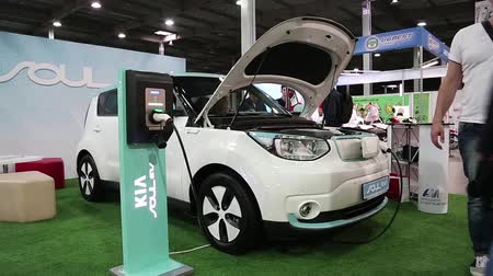 electromotor : UKRAINE, KIEV, JUNE 10, 2016: People at exhibition of electric cars. People near KIA Soul EV electromobile