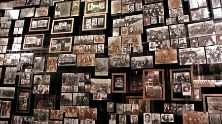 képek : UKRAINE, KIEV, MAY 9, 2016: Retro photo exhibition in national museum of history of Ukraine in World War 2. Wall with old photos