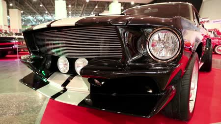 anual : KIEV, UKRAINE, MAY 31, 2013: Black Ford Mustang at yearly automotive-show in Kiev, Ukraine
