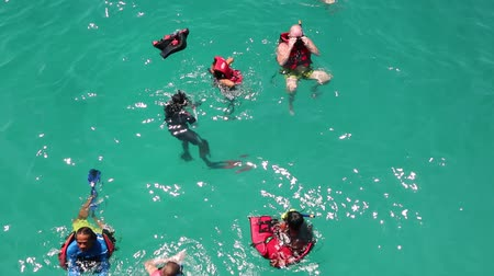 plunging : THAILAND, GULF OF SIAM, NEAR KOH CHANG ISLAND, APRIL 8, 2014: Snorkelers swimming in the Gulf of Siam in Thailand