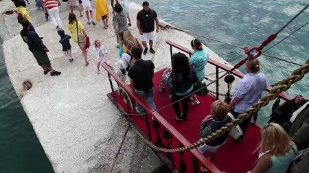 embarcadero : GREECE, ATHENS, JUNE 4, 2013: People walk the gangway of the ship
