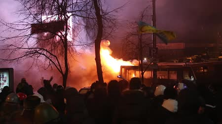 anti war : UKRAINE, KIEV, JANUARY 19, 2014: Thousands of anti-government protesters clashed with riot police, burning police buses and attacking with stones, sticks and fires after tough laws were passed.