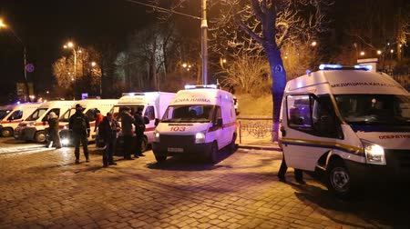 aggrieved : UKRAINE, KIEV, JANUARY 19, 2014: Thousands of anti-government protesters clashed with riot police, burning police buses and attacking with stones, sticks and fires after tough laws were passed. Ambulance cars