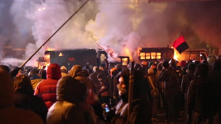 переполох : UKRAINE, KIEV, JANUARY 19, 2014: Thousands of anti-government protesters clashed with riot police, burning police buses and attacking with stones, sticks and fires after tough laws were passed.