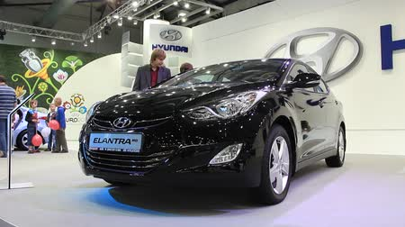 anual : KIEV, UKRAINE, MAY 26, 2011: Black Hyundai Elantra MD at yearly automotive-show SIA 2011.