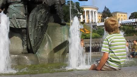 kiddy : UKRAINE, KIEV, AUGUST 15, 2009: Boy siting by fountain