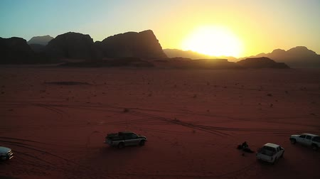 Cars in Wadi Rum desert, Hashemite Kingdom of Jordan. Wadi Rum, also known as the Valley of the Moon, is the largest and picturesque desert in Jordan. Wadi is a term traditionally referring to a valley Stock Footage