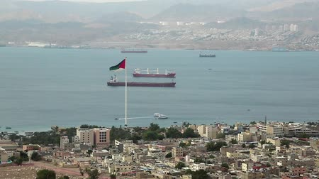 mussulman : View of Aqaba city in Jordan and Eilat city in Israel. View from mountain in Aqaba city in Jordan. Two city and two country in one video clip Stock Footage