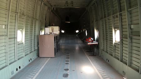 mi : Interior of MI-26 heavy cargo-and-passenger helicopter. Inside the helicopter. Empty interior of old helicopter. Interior of helicopter without buyer seats Stock Footage