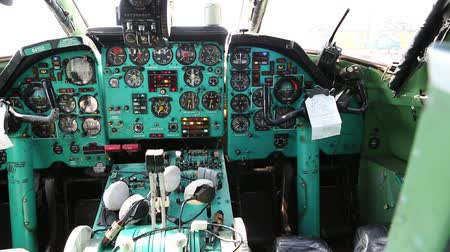 UKRAINE, KIEV, AUGUST 10, 2016: Old aircraft cabin. Tu-134UBL Combat Trainer. Aircraft instruments panel, interior of old airplane since the Soviet Union Стоковые видеозаписи