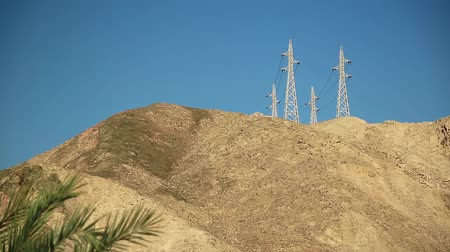 Power line in the mountains. Power transmission towers