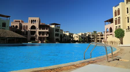 aqaba : JORDAN, AQABA, DECEMBER 10, 2016: Outdoor swimming pool with clean water in hotel at Tala Bay resort near Aqaba city, Hashemite Kingdom of Jordan