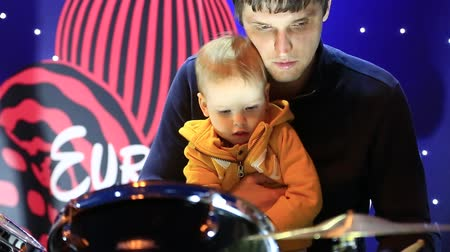kiddy : UKRAINE, KYIV, MAY 1, 2017: Father with child plays drums in Kyiv main street Khreschatyk in Ukraine