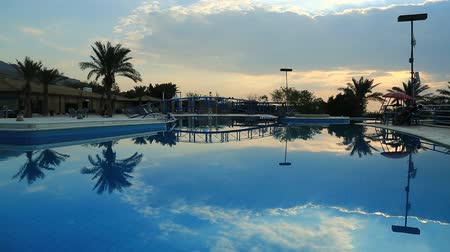 aqaba : JORDAN, DECEMBER 15, 2016: Swimming pool with blue clean water in hotel near Dead Sea in Hashemite Kingdom of Jordan Stock Footage