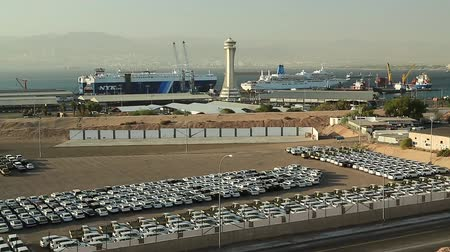 aqaba : JORDAN, AQABA, DECEMBER 20, 2016: Aqaba sea port, Jordan. Storage facility of new cars Stock Footage
