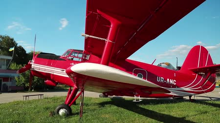 UKRAINE, KIEV, AUGUST 23, 2016: Red small propeller-driven aircraft Antonov An-2 in Kiev aviation museum. Is a Soviet mass-produced single-engine biplane. Agricultural and utility aircraft Stock Footage