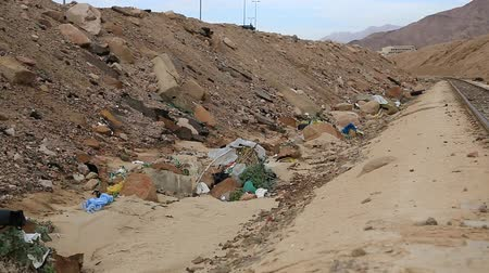 aqaba : Garbage lies near narrow gauge railway in Aqaba, Jordan. Trash lies near decauville. Rubbish near light railway