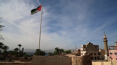 Aqaba fort near the flag of the Arab Revolt in Aqaba, Jordan. Aqaba Castle, Mamluk Castle or Aqaba Fort, adjacent to the fort is an archaeological museum. Aqaba - only coastal city in Hashemite Kingdom of Jordan Stock Footage