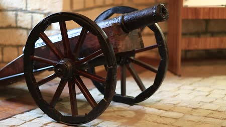 антиквариат : Old cannon with wheels. Cannon carriage wheels