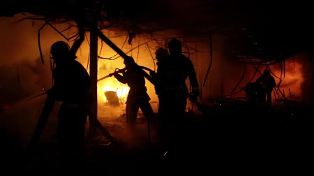 extinguishing : Brave firemen. Fire extinguishing, fire brigade inside burning premises. House is burned by fire