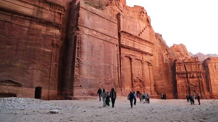 JORDAN, PETRA, DECEMBER 5, 2016: Tourists in ancient Petra, originally known to Nabateans as Raqmu - historical and archaeological city in Hashemite Kingdom of Jordan