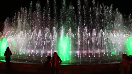 UKRAINE, KYIV, MAY 5, 2017: People near colorful fountains on Independence Square in Kyiv, Ukraine Стоковые видеозаписи