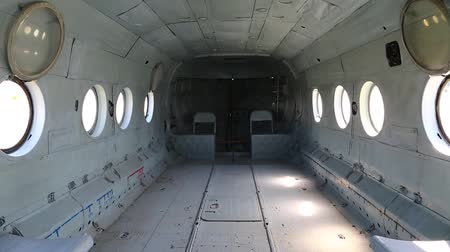 alaplap : Interior of helicopter. Inside the helicopter. Empty interior of old helicopter. Interior of helicopter without buyer seats Stock mozgókép