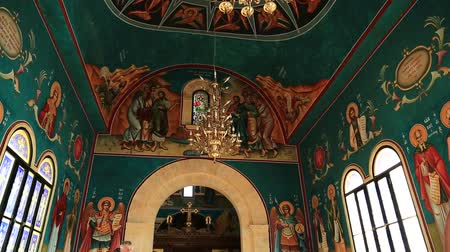 JORDAN RIVER, AL-MAGHTAS, DECEMBER 8, 2016: People in St John Baptist Church. The newly built Greek Orthodox Church of John the Baptist in Al-Maghtas, a historical place of baptism of Jesus Christ, Jordan Стоковые видеозаписи