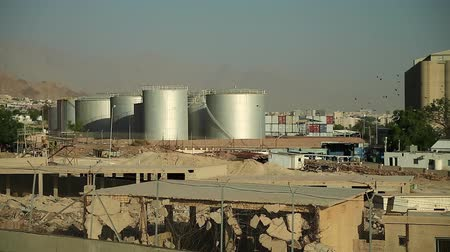 depositary : Large capacity tanks in Aqaba city, Jordan. Industrial objects near port terminal in Aqaba, Hashemite Kingdom of Jordan