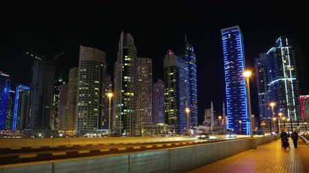 Dubai Marina night time lapse, United Arab Emirates. Dubai Marina is the largest man-made marina in the world. Caravan along a 3 km stretch of Persian Gulf shoreline, UAE Stock Footage