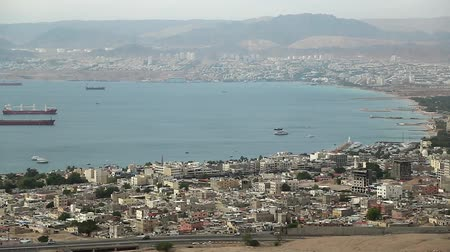 aqaba : Panorama of Aqaba in Jordan and Eilat city in Israel. View from mountain in Aqaba city in Jordan. Two city and two country in one video clip