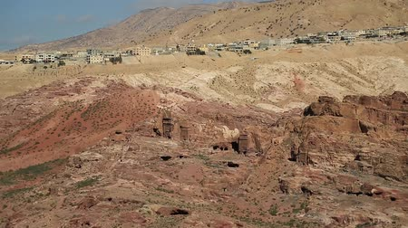 sepulcher : Top view of old tombs in Nabatean rock-cut temple of Hellenistic period of ancient Petra, originally known to Nabataeans as Raqmu - historical city in Hashemite Kingdom of Jordan Stock Footage