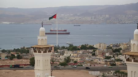 aqaba : View of the Aqaba city and gulf of Aqaba in Hashemite Kingdom of Jordan and Eilat city in Israel at the distance. View from mountain in Aqaba city, Jordan. Two city and two country in one video clip