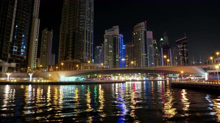 эмираты : UHD 4K Dubai Marina night time lapse, United Arab Emirates. Dubai Marina is the largest man-made marina in the world. Dubai Marina is a canal city, carved along a 3 km stretch of Persian Gulf shoreline
