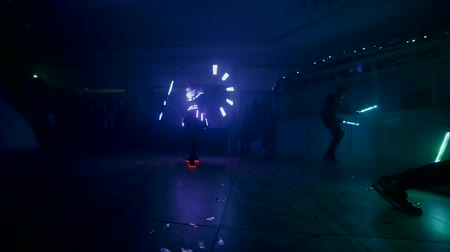 deceleration : Led Show. People dance in light costumes. Slow motion