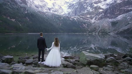 Couple hold hands. Marine eye. Carpathians Tatras Poland. Morskie Oko Stok Video