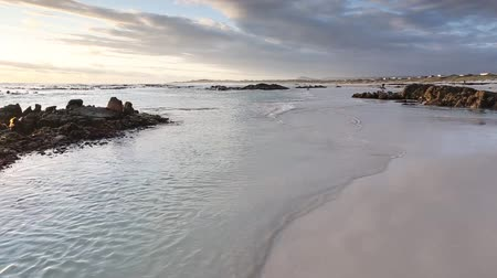 garden route : Lovely sunset on the garden route coastline in the small town of Gansbaai, the Great White shark capital of the world Stock Footage