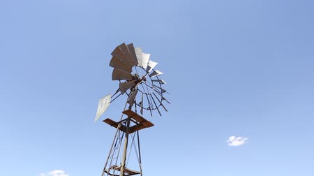 eixo : agricultural windpump rotating against a bright blue sky