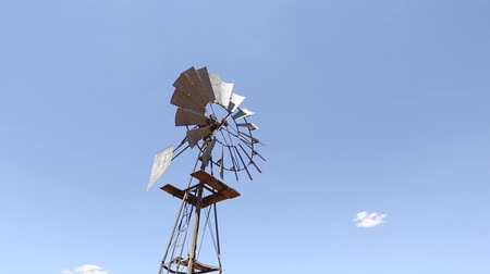 eixo : windpump rotating against a bright blue sky